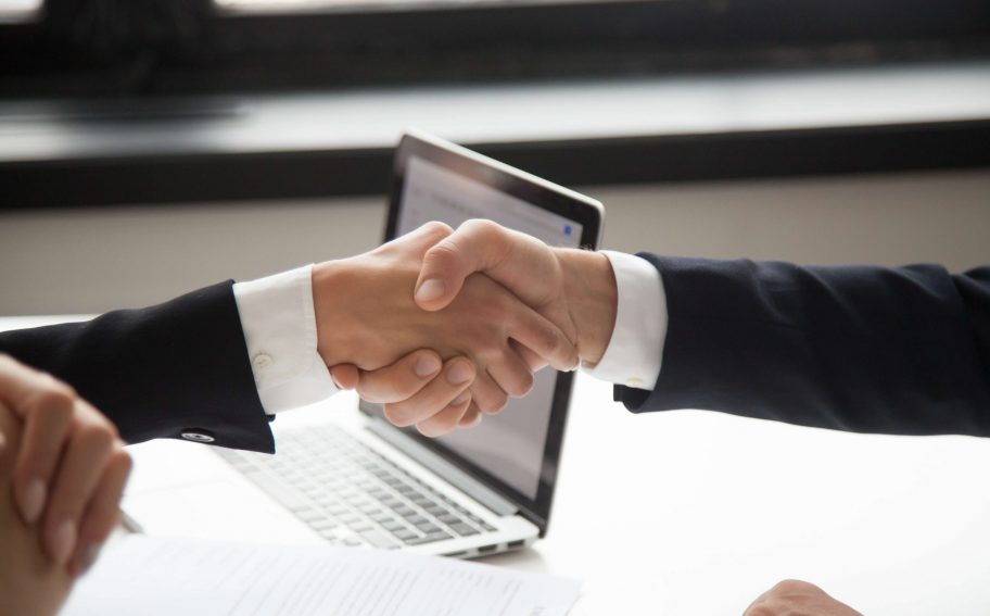 Businessman handshaking businesswoman as concept of good business deal and respect for new partner, successful partnership and great teamwork, hiring, close up view of male female hands shaking